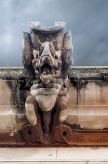 Picture of a gargoyle with great details.