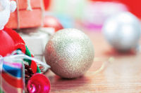 Balls and gifts on wooden.