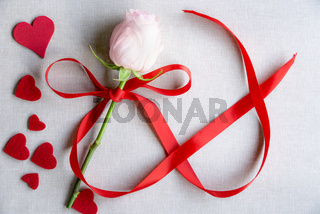 Hearts and a rose with ribbon in shape of infinity