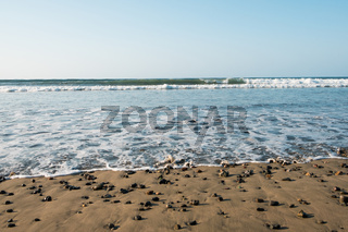 ocean view , wave on beach with colorful pebble stones