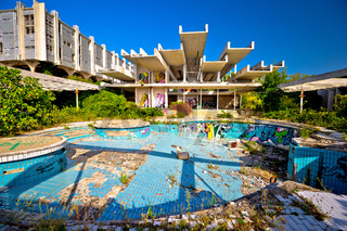 Abandoned and destructed luxury hotel exterior