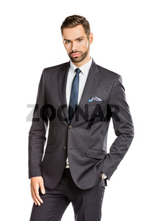 Handsome young businessman standing confident on white background