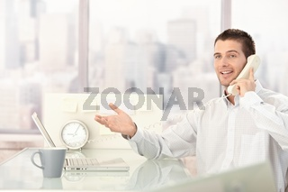 Handsome businessman chatting on phone