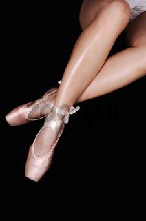 The legs of a ballerina.