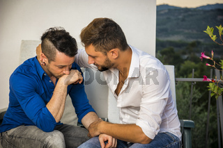 Male couple having relationship problem