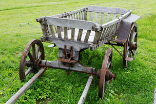 wooden cart on a meadow on a summer day