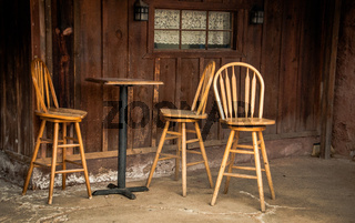 Wooden bar stools and bar table in calico ghost town