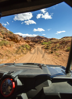 View from the inside of the off road vehicle White Rim Road Utah trails straight ahead