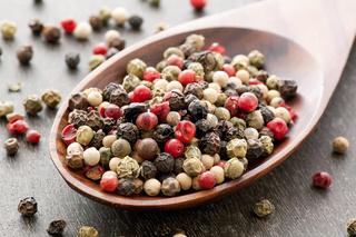 Pepper corn mix as closeup on teak spoon