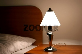 Lamp next to the bed in night