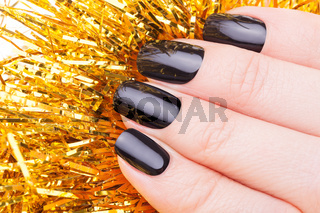 Very beautiful black nails closeup with rain.