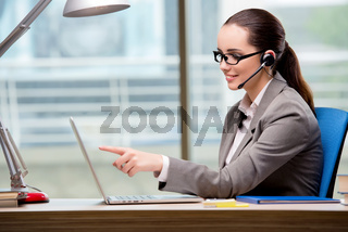 The call center operator working at her desk