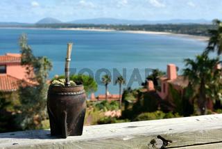 Hot traditional caffeine-rich drink Mate (Yerba Mate) In A Calabash Gourd, Uruguay