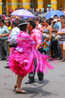 Local people dancing during Festival of the Virgin de la Candelaria in Lima, Peru