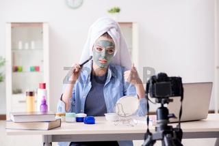 Beauty blogger recording video for vlog
