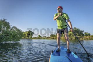 senior male paddler on paddleboard