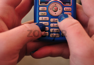 Text Messaging using a blue cell phone