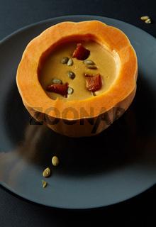 Pumpkin soup on the plate
