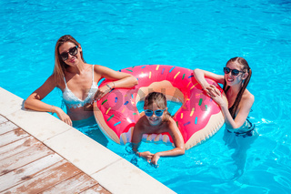 mother with two daughters in the pool