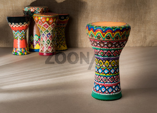 Decorated colorful pottery goblet drum on background of goblet drums