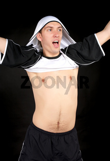 Exulting player showing expression of victory with sports shirt over head