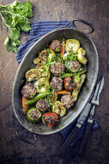 Rice Meatballs with Vegetable in Copper Pod