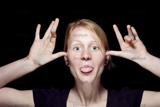 Zunge rausstrecken bedeutung