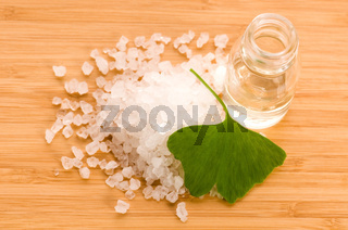 fresh leaves ginko biloba essential oil and sea salt - beauty treatment