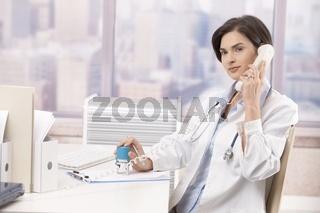 Female doctor talking on phone