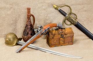 Bottle, rapier, sword, pistol and chest