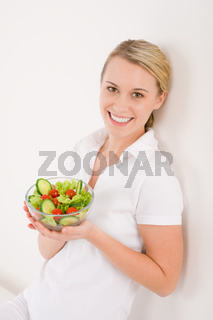 Healthy lifestyle - smiling woman with vegetable salad
