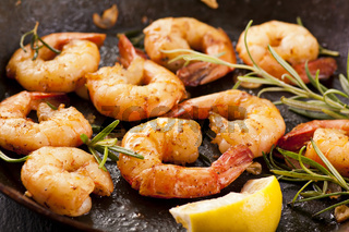 fried prawns with fresh rosmarin and lemon juice