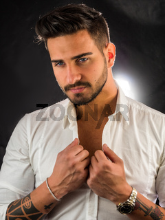 Handsome young man with elegant shirt in studio