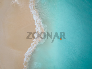 Aerial from Eagle beach on Aruba in the Caribbean, bird ey view at the beach with umbrella at Aruba Eagle beach