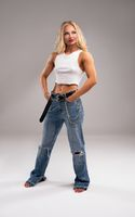 Strong blond female model in casual clothes