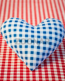 Blue heart on gingham tablecloth