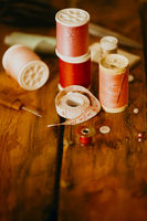 Sewing supplies on wooden table