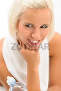 Attractive blond fitness woman with water bottle