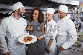 Restaurant manager interacting with his kitchen staff