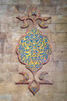 Golden and blue stucco floral patterns decoration carved into the wall of Al Rifai Mosque, Cairo, Egypt
