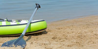 Stand up paddle board on the beach