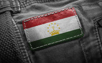 Tag on dark clothing in the form of the flag of the Tajikistan