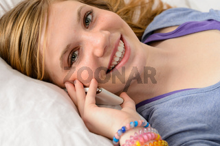 Portrait of teenager girl talking on phone