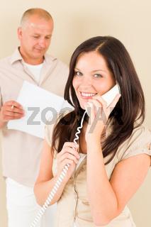 Casual businesswoman calling phone man colleague