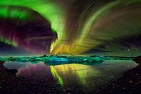northern lights aurora in Jokulsarlon glacial river lagoon