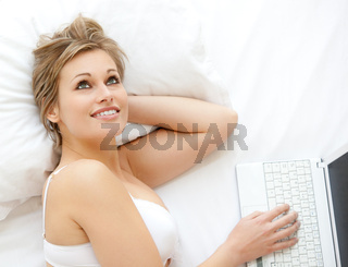 Blond woman in front of her laptop