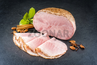 Modern style traditional German boiled Christmas ham with almond