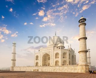 Taj Mahal on sunrise. Indian Symbol - India travel background. Agra