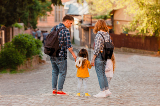 Family walking down the street of old city