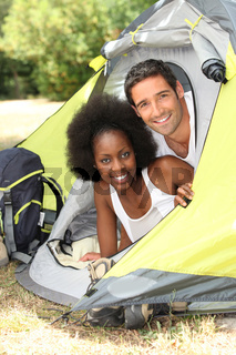 Smiling couple in a tent